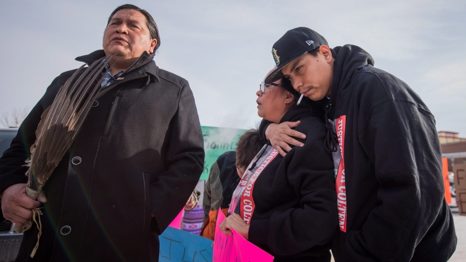 Alvin Baptiste, Colten Boushie's uncle, stands with Colten's mother Debbie Baptiste and brother Jace Boushie as demonstrators gather outside of the courthouse in North Battleford, Sask., on Saturday, February 10, 2018. (THE CANADIAN PRESS/Matt Smith)