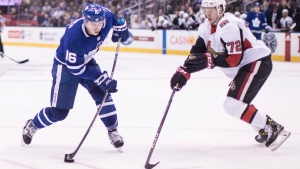 Toronto Maple Leafs' Mitchell Marner (left) gets a shot on goal as Ottawa Senators' Thomas Chabot defends during second period NHL hockey action in Toronto, on Saturday, February 10, 2018. (THE CANADIAN PRESS / Chris Young)