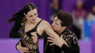 Tessa Virtue and Scott Moir of Canada perform during the ice dance short dance team event in the Gangneung Ice Arena at the 2018 Winter Olympics in Gangneung, South Korea, Sunday, Feb. 11, 2018. (AP Photo/Julie Jacobson)
