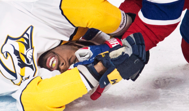 Nashville Predators' P.K. Subban is held down on the ice by Montreal Canadiens' Charles Hudon during first period NHL hockey action in Montreal, Saturday, February 10, 2018. (THE CANADIAN PRESS/Graham Hughes)