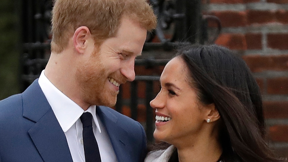 In this file photo dated Monday Nov. 27, 2017,  Prince Harry and his fiancee Meghan Markle pose for photographers in the grounds of Kensington Palace in London, following the announcement of their engagement.  (AP Photo/Matt Dunham, FILE)