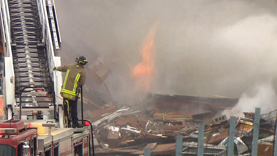 A firefighter on the scene of the building explosion in Mississauga, Ont.