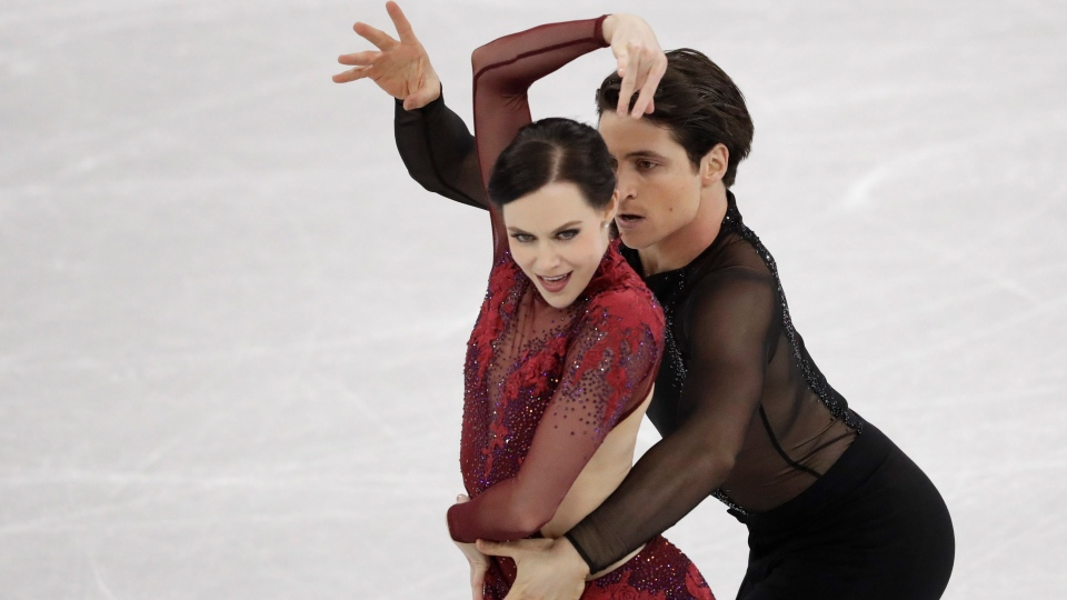 Scott Moir and Tessa Virtue of Canada perform in the ice dance free dance figure skating team event in the Gangneung Ice Arena at the 2018 Winter Olympics in Gangneung, South Korea, Monday, Feb. 12, 2018. (AP Photo/Bernat Armangue)