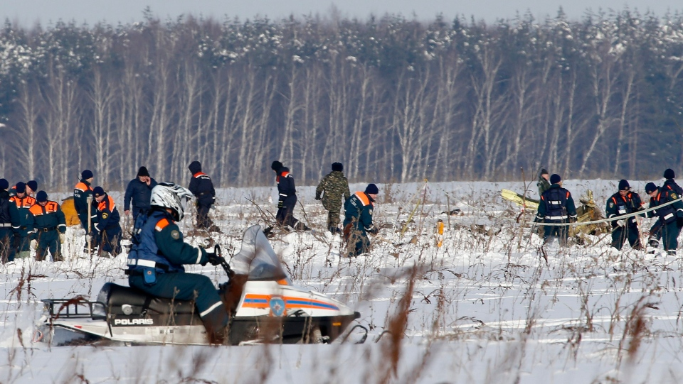 Personnel work at the scene of a AN-148 plane crash in Stepanovskoye village, about 40 kilometres from the Domodedovo airport, Russia, Monday, Feb. 12, 2018. (AP Photo/Alexander Zemlianichenko)