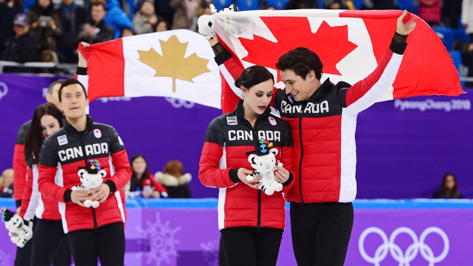Canada's Scott Moir, right to left, Tessa Virtue, and Patrick Chan celebrate their gold medal victory in the team figure skating event at the Pyeonchang Winter Olympics on Feb. 12, 2018. (Paul Chiasson / THE CANADIAN PRESS)