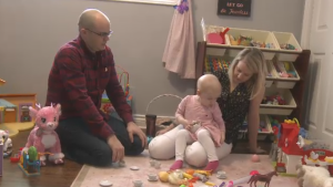 Mélia Payne plays with her parents, Kevin and Tiffany.