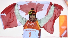 Mikael Kingsbury celebrates his gold medal