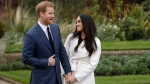 In this file photo dated Monday Nov. 27, 2017, Britain's Prince Harry and his fiancee Meghan Markle pose for photographers in the grounds of Kensington Palace in London, following the announcement of their engagement. (AP Photo/Matt Dunham)