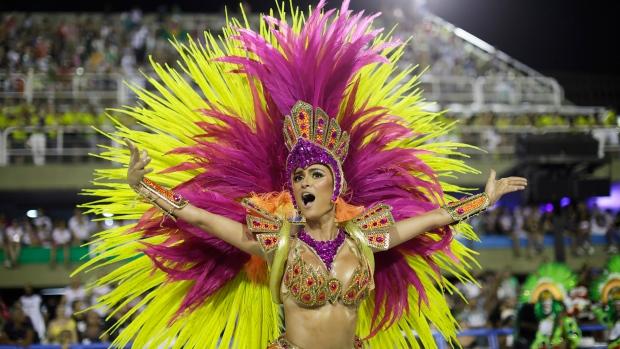 A performer from Academicos do Grande Rio samba school parades during Carnival celebrations at the Sambadrome in Rio de Janeiro, Brazil, Monday, Feb. 12, 2018. (AP Photo/Leo Correa)