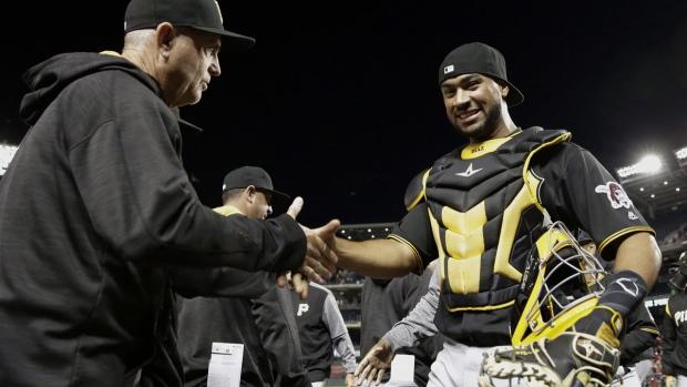 Pittsburgh Pirates' Elias Diaz, right