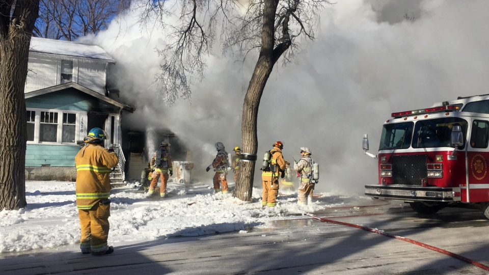 Smoke billowed from a home on Rae Street after fire broke out on Monday morning. (MADINA AZIZI/CTV REGINA)