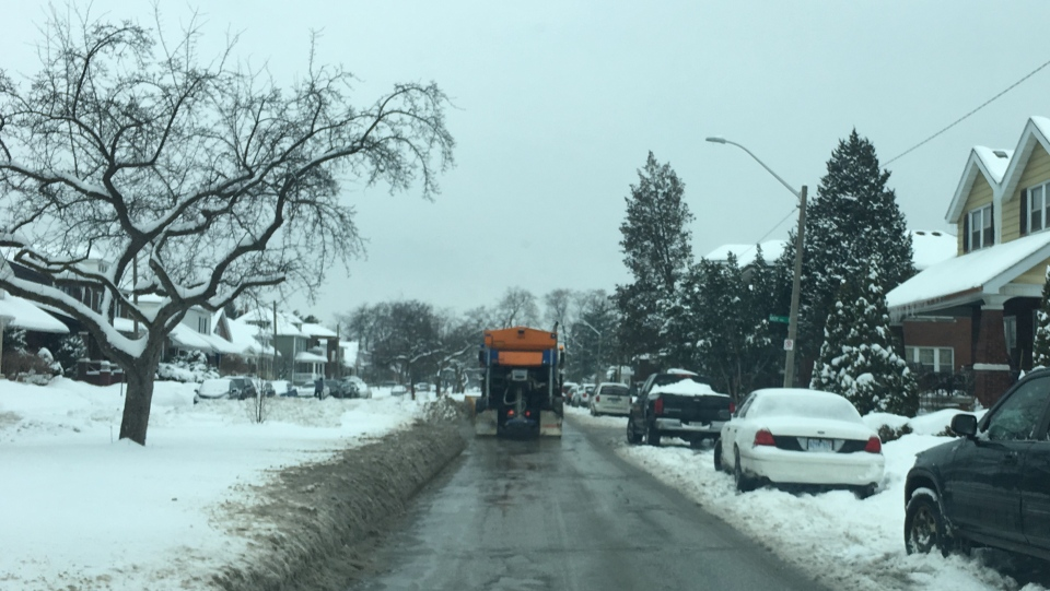 A Windsor snow plow clears Giles Boulevard in Windsor, Ont., on Sunday, Feb. 11, 2018. (Melanie Borrelli / CTV Windsor)