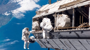 In this Dec. 12, 2006, file photo, made available by NASA, astronaut Robert L. Curbeam Jr., left, and European Space Agency astronaut Christer Fuglesang, participate in a space walk during construction of the International Space Station. (NASA via AP, File)