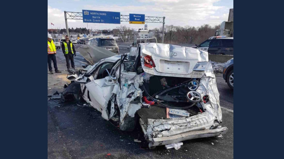 A crushed passenger vehicle that was involved in a multi-vehicle crash on Highway 401 near Weston Road on Feb. 12, 2018. (Twitter/Kerry Schmidt@OPP_HSD)