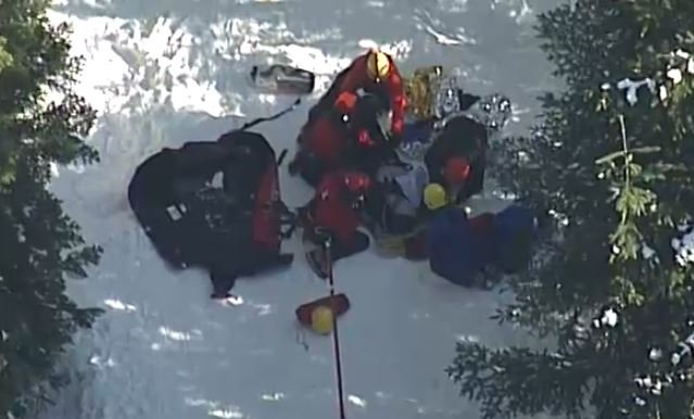 Rescuers prepare to longline out a showshoer on Feb. 12, 2018.
