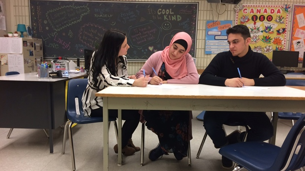 Students at Kildonan-East Collegiate wrote stories for a book called 'Dual Language Stories'. It tells tales in both their mother tongues and English. (Beth Macdonell/CTV News)