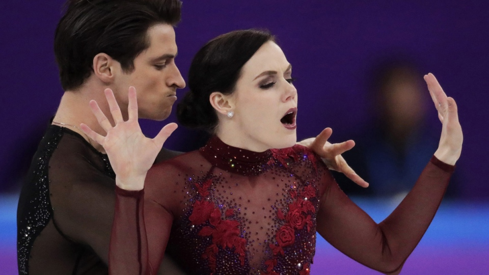 Scott Moir and Tessa Virtue perform in the ice dance free dance figure skating team event in the Gangneung Ice Arena, on Feb. 12, 2018. (Julie Jacobson / AP)