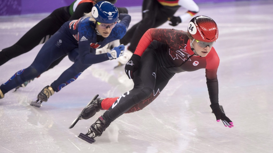Canada's Kim Boutin takes the lead in the women's 500-metre short-track speed skating quarter finals on Feb. 13, 2018. (Paul Chiasson / THE CANADIAN PRESS)