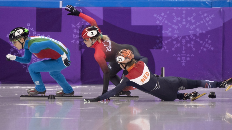 Canada's Marianne St Gelais interferes with skater Yara van Kerkhof of the Netherlands behind Arianna Fontana of Italy during the women's 500-metre short-track speedskating quarter finals on Feb. 13, 2018. (Paul Chiasson / THE CANADIAN PRESS)