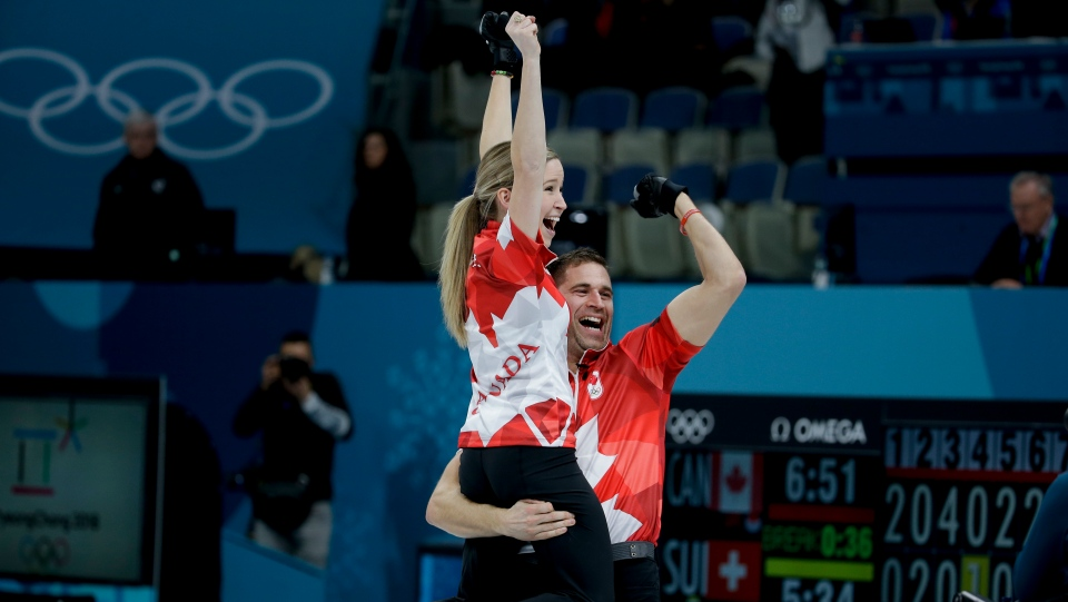 Canada's Kaitlyn Lawes, left, and John Morris celebrate winning the mixed doubles final curling match against Switzerland Jenny Perret and Martin Rios at the 2018 Winter Olympics in Gangneung, South Korea, Tuesday, Feb. 13, 2018. (AP Photo/Natacha Pisarenko)