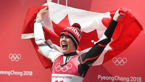 Alex Gough celebrates with the Canadian flag