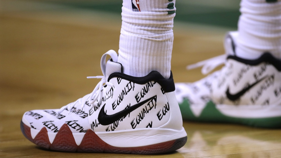 The word 'Equality' adorns the athletic shoes worn by Boston Celtics guard Kyrie Irving on Jan. 16, 2018. (Charles Krupa / AP)