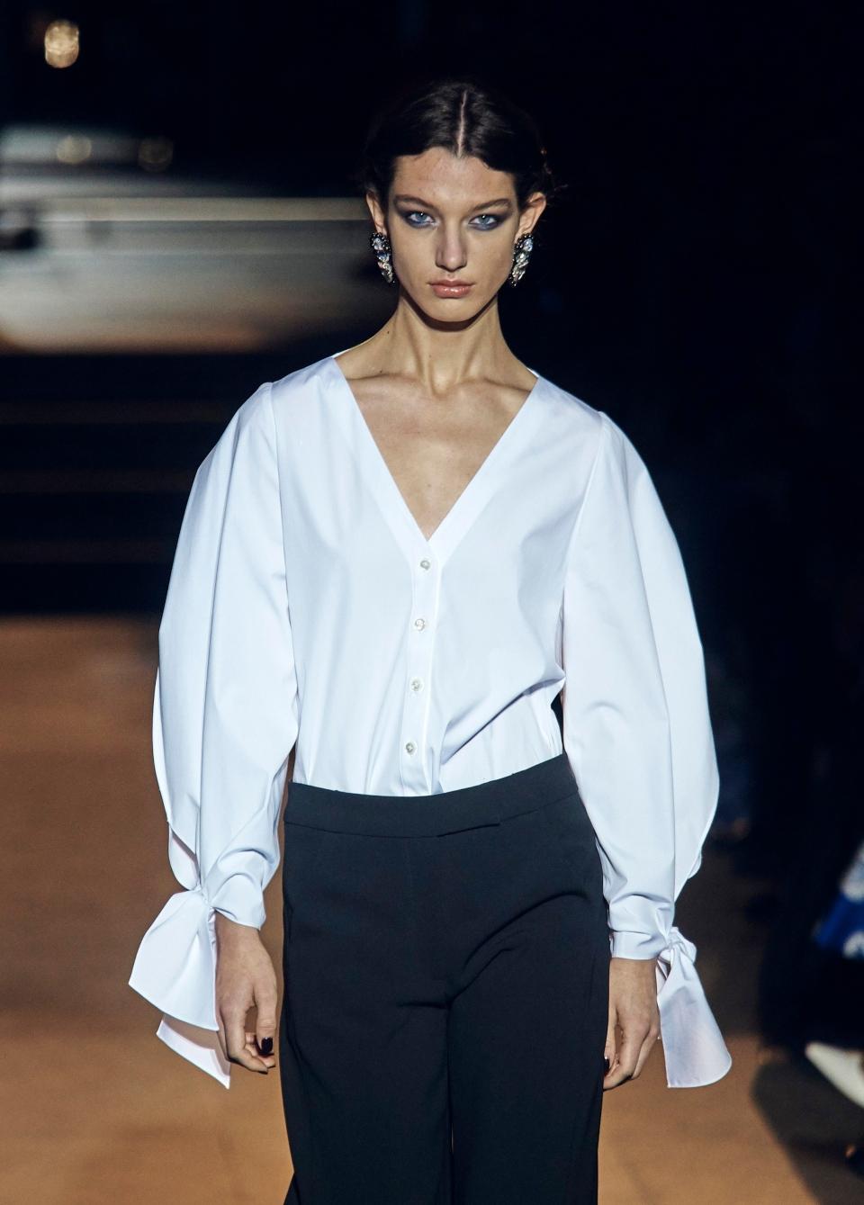 Fashion from Carolina Herrera collection is modeled during Fashion Week in New York, Monday, Feb. 12, 2018. (AP Photo/Andres Kudacki)
