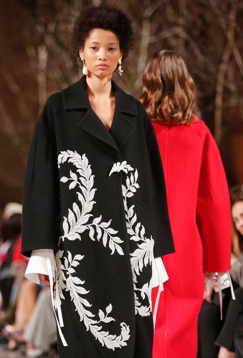 Fashion from Oscar de la Renta is modeled during Fashion Week, Monday Feb. 12, 2018, in New York. (AP Photo/Bebeto Matthews)