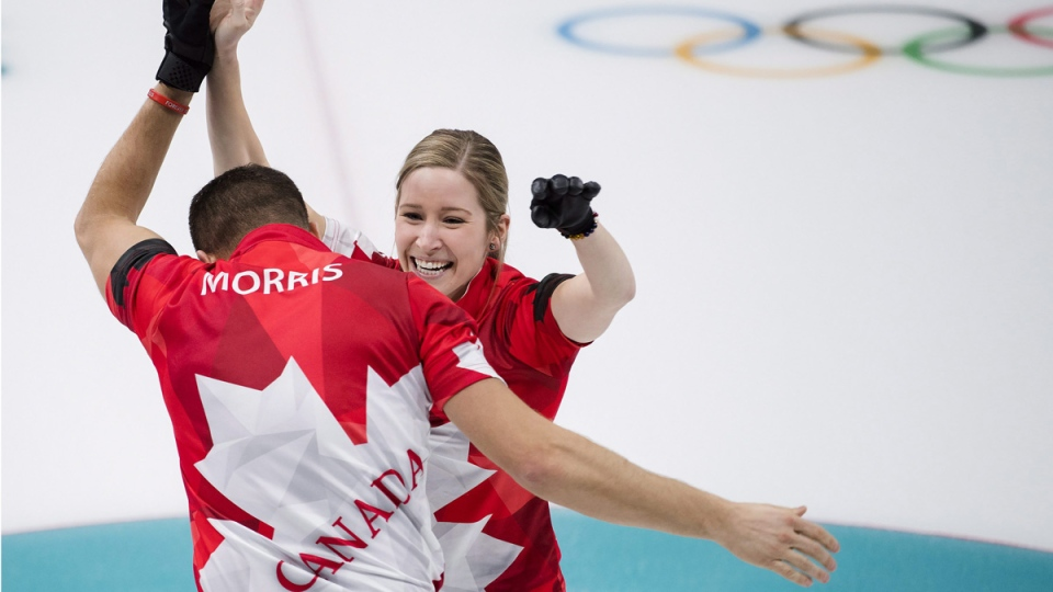 Kaitlyn Lawes and John Morris react after defeating Switzerland to win gold at the 2018 Olympic Winter Games on Feb. 13, 2018. (Nathan Denette / THE CANADIAN PRESS)