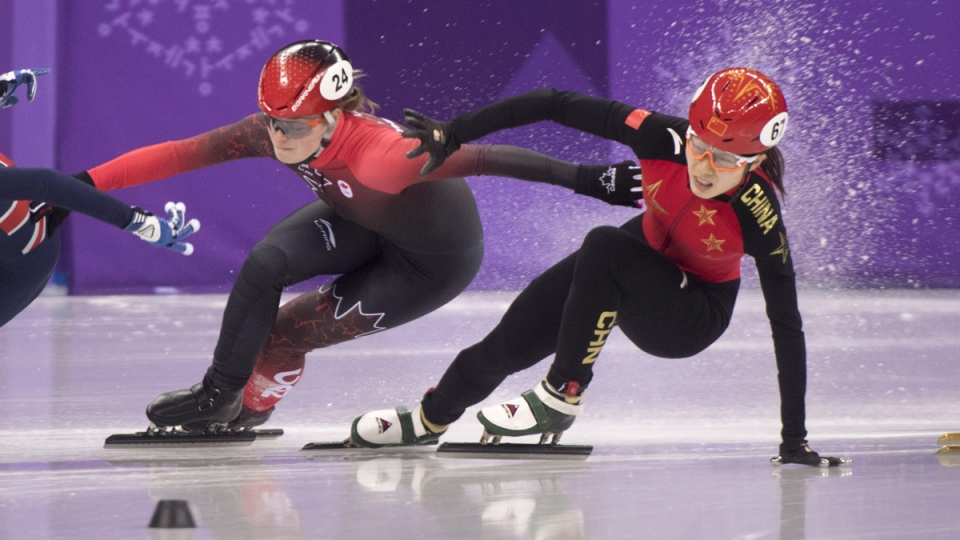 Canada's Kim Boutin is interfered with by Qu Chunyu, of China, during the women's 500-metre short-track speedskating semifinals on Feb. 13, 2018. (Paul Chiasson / THE CANADIAN PRESS)
