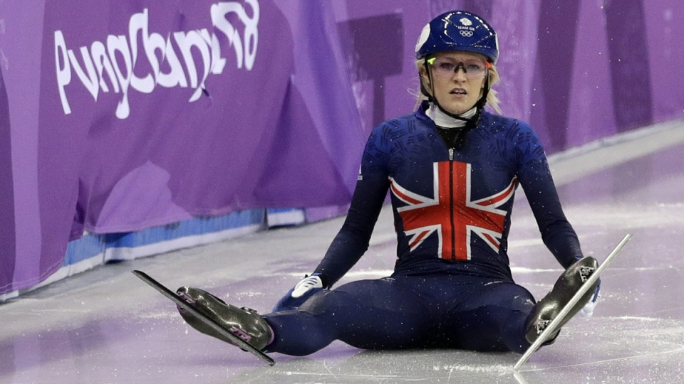 Elise Christie of Britain sits on the ice after crashing during the 500 metres short track speedskating final on Feb. 13, 2018. (David J. Phillip / AP)