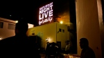 """In this Tuesday, Feb. 16, 2016 file photo, people wait for this first """"Saturday Night Live Arabia,"""" show to start in Cairo, Egypt. (AP Photo/Nariman El-Mofty, File )"""