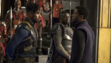 Actors Michael B. Jordan, left, Chadwick Boseman, right, Daniel Kaluuya, back, are seen during a scene in 'Black Panther.'  (Disney/Marvel Studios)