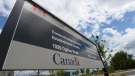 A sign for the Government of Canada's Communications Security Establishment (CSE) is seen outside their headquarters in the east end of Ottawa on July 23, 2015. (Sean Kilpatrick/THE CANADIAN PRESS)