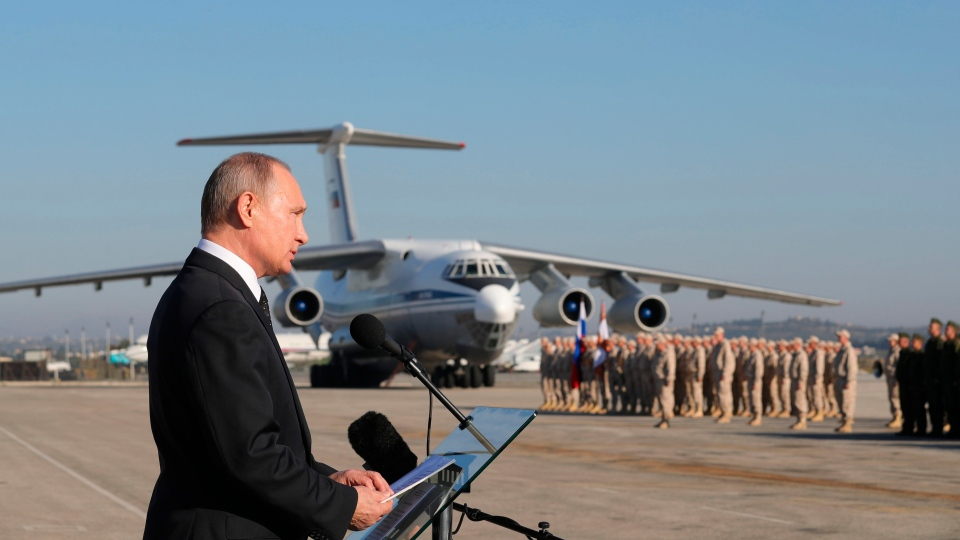 In this file photo taken on Tuesday, Dec. 12, 2017, Russian President Vladimir Putin addresses the troops at the Hemeimeem air base in Syria. (Mikhail Klimentyev/Pool Photo via AP, File)
