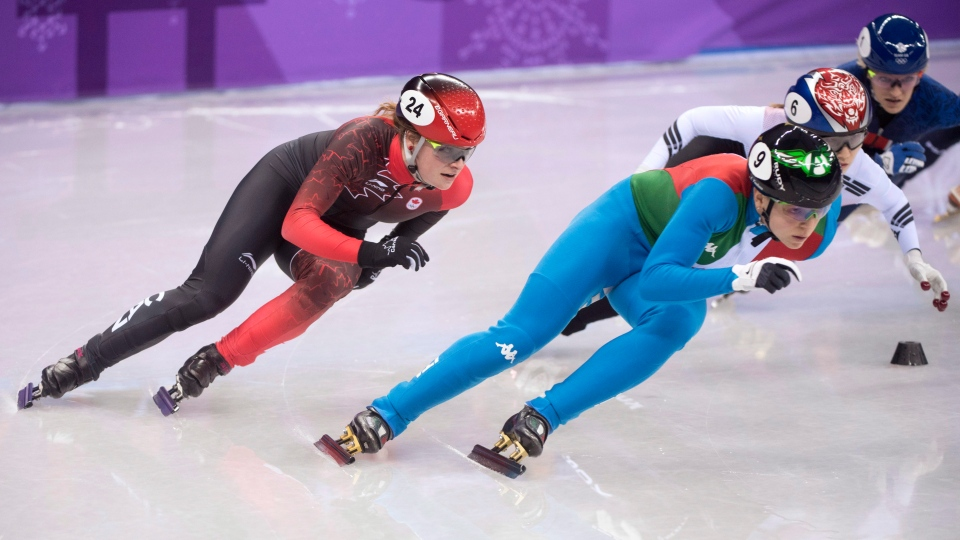 Canadian bronze medallist Kim Boutin, left, skates behind gold medalist Arianna Fontana, of Italy, in the women's 500-metre short-track speedskating final at the Pyeongchang Winter Olympics in Gangneung, South Korea on Tuesday, Feb. 13, 2018. (Paul Chiasson/THE CANADIAN PRESS)