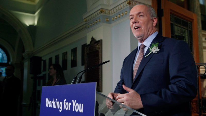 Premier John Horgan answers questions from the media following the speech from the throne in the legislative assembly in Victoria, B.C., on Tuesday, February 13, 2018. THE CANADIAN PRESS/Chad Hipolito