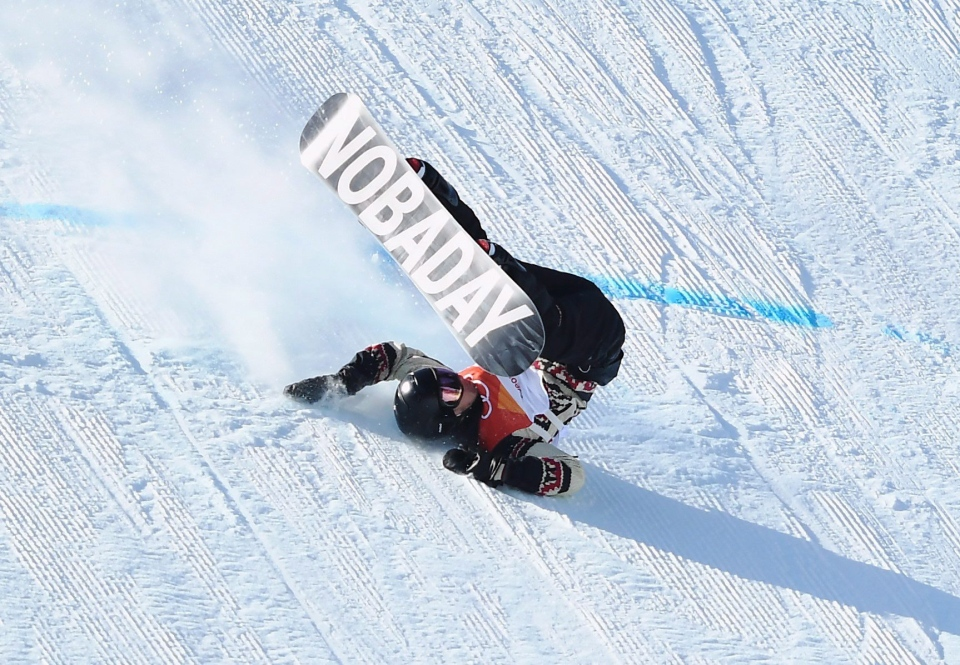 Max Parrot, of Canada, crashes in the men's snowboard slopestyle final at the Phoenix Snow Park at the 2018 Winter Olympic Games in Pyeongchang, South Korea, Sunday, Feb. 11, 2018. (Jonathan Hayward/THE CANADIAN PRESS)