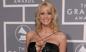In this Feb. 11, 2007, file photo, Stormy Daniels arrives for the 49th Annual Grammy Awards in Los Angeles. (Matt Sayles/AP Photo)