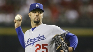 Los Angeles Dodgers' Esteban Loaiza throws a pitch against the Arizona Diamondbacks in the first inning of a baseball game in Phoenix on Sept. 21, 2007. (AP Photo/Ross D. Franklin)