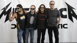 FILE - This is a Friday, Sept. 12, 2008 file photo of member of rock backs Metallica Robert Trujillo, Lars Ulrich, Kirk Hammett and James Hetfield, from left, as they pose for the media while promoting their new album 'Death Magnetic' in Berlin. (AP Photo/Miguel Villagran/File)