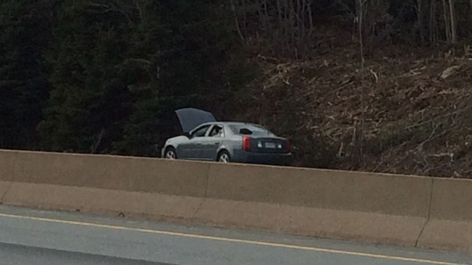Police are investigating after a suspicious package was found inside this abandoned car on Highway 102 on Feb. 14, 2018.