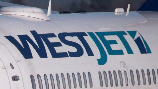 A pilot taxis a WestJet plane to a gate on Monday, February 3, 2014. (THE CANADIAN PRESS/Darryl Dyck)