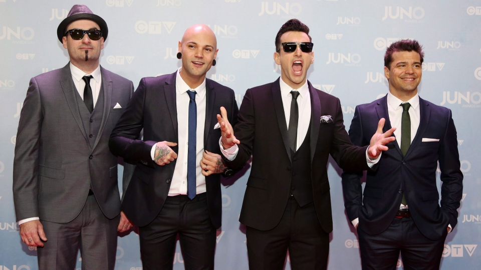 Members of the band Hedley pose on the red carpet during the 2015 Juno Awards in Hamilton, Ont., on Sunday, March 15, 2015. THE CANADIAN PRESS/Peter Power