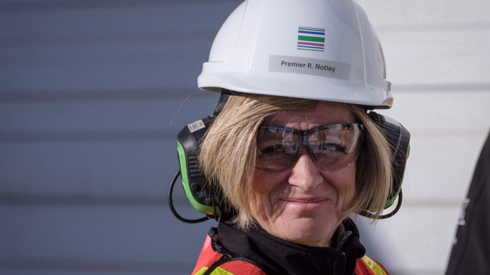 Alberta Premier Rachel Notley tours a company producing pipe, casing and tubing for the Canadian oil and gas sector in Calgary, Alta., Friday, Feb. 9, 2018. THE CANADIAN PRESS/Jeff McIntosh