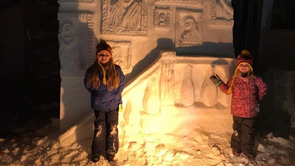 Kelly Davies' daughters Anna, 8, and Julia, 5, check out the Hogwarts sculptures in their front yard.