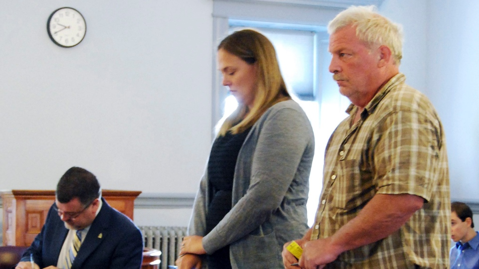 Mark Johnson, right, stands next to public defender Rosie Chase, center, during his arraignment in August.(Tonya Poutry/The Islander via AP, Pool, File)