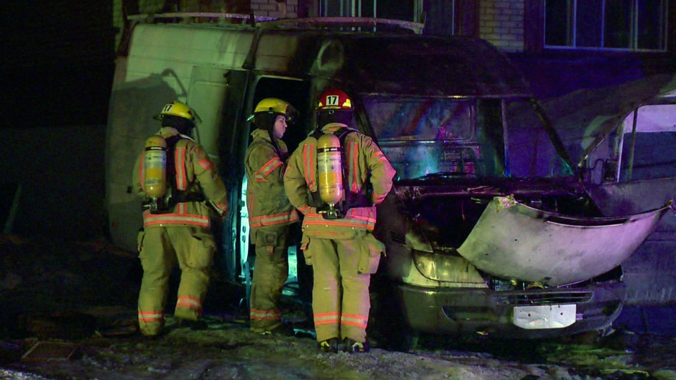 Firefighters examine a burnt van in Montreal North on Thursday Feb. 15, 2018 (CTV Montreal/Cosmo Santamaria)