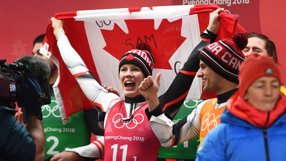 Team Canada celebrate their silver medal in Luge team relay finals in at the 2018 Olympic Winter Games in Pyeongchang, South Korea, on Thursday, February 15, 2018. (THE CANADIAN PRESS/Jonathan Hayward)