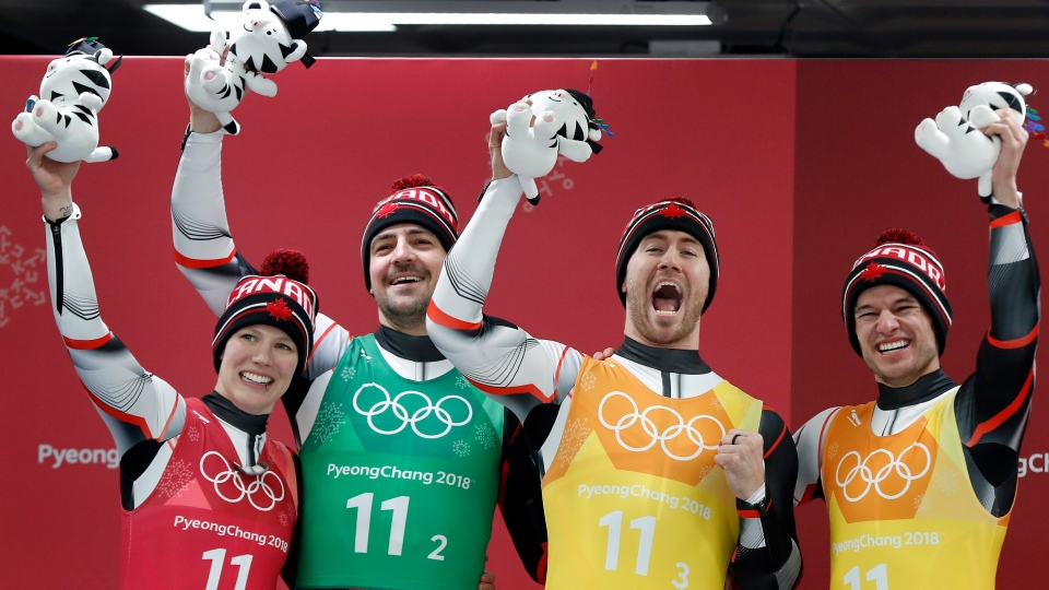 From left Alex Gough, Sam Edney, Tristan Walker and Justin Snith of Canada celebrates winning the silver medal in the finish area after the luge team relay at the 2018 Winter Olympics in Pyeongchang, South Korea, Thursday, Feb. 15, 2018. (AP Photo/Andy Wong)